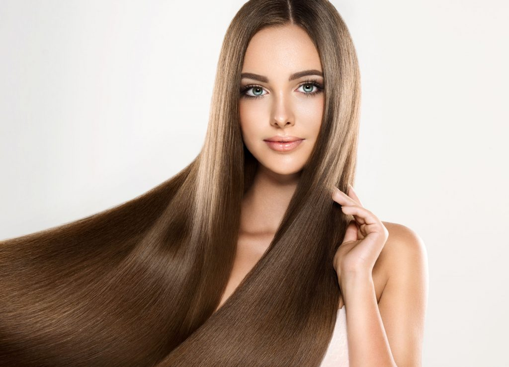 64277917 - young attractive girl-model with gorgeous, shiny, long, straight hair. good and healthy hair as resalt of right care.